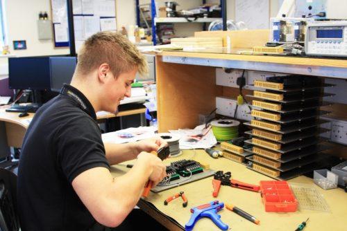 Like Tech engineer Matthew Humphries rewiring some hardware