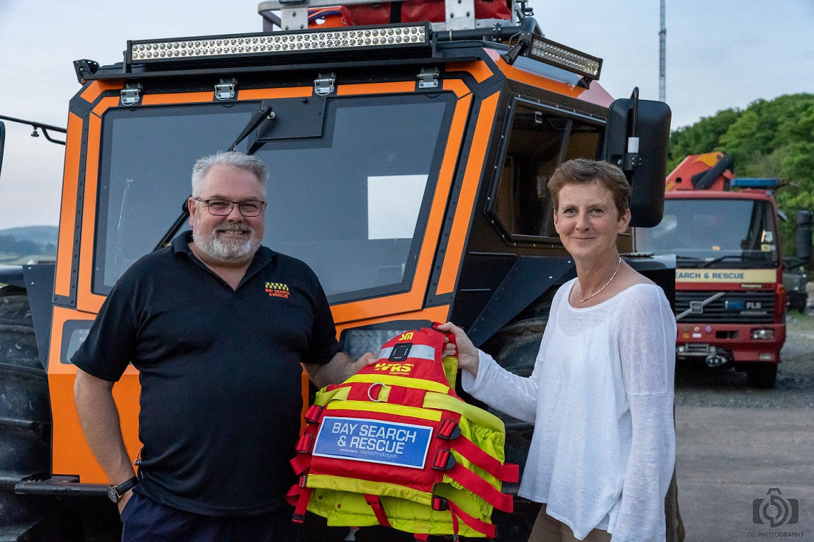 Kate Houlden, Managing Director of Like Technologies, officially hands over the new flotation devices to Bay Search and Rescue
