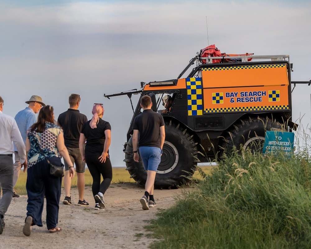 Staff from Like Technologies attend a demonstration from Bay Search and Rescue